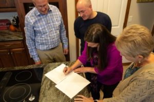 John and Donna signing Paperwork with Client Compressed