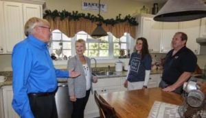 John and Donna with Clients in the Kitchen Compressed